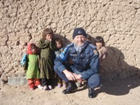 EUPOL Superintendent Gibson with local children in Bamyan, Afghanistan.