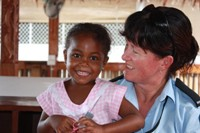 New Zealand Police Constable Anita Osborne with young Solomons girl.