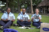 Solomon Islands White Ribbon day: Cathy Hoiau (Solomon Islands Police officer) and Lawrence Iko (National Family Violence Coordinator) with New Zealand Police Constable Jo Linton.