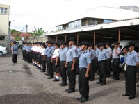 Tonga Police Beat Section lining up for inspection before start of duty.