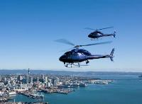 Eagle Air Support helicopters flying over Auckland City.