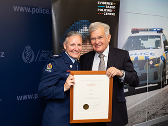 Senior Sergeant Lyle Norriss, Auckland and Sir Noel Robinson, Chairman of the Woolf Fisher Trust.