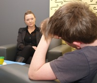 A child interviewer talking to a young boy.