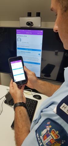 Senior Sergeant Stu Duncan demonstrates the Police family harm app