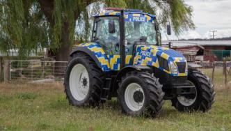 The police branded tractor is on it's way to the Gore Santa Parade.