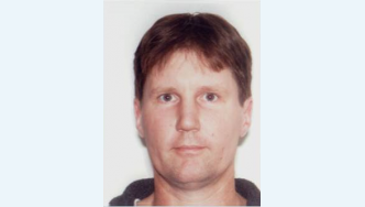 McNee is a 44 year old Caucasian male, clean shaven, thin build and 180cm tall with short light brown hair
