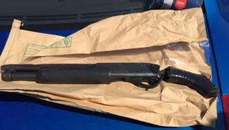 A shotgun recovered by Police during the investigation