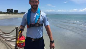 Constable Daniel Ross with a new water safety kit