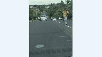 Image of offender and getaway car from Pizza Hutt robbery in New Plymouth