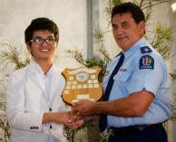 Thai An accepts the speech award from Superintendent Wally Haumaha