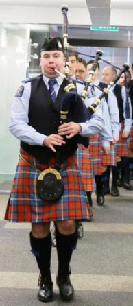 Pipe Major Emmett Conway pipes in the new tartan