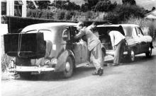 1948 black and white image of DSIR-built radar mounted on back of car.