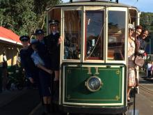 North: The torch goes by tram at MOTAT in Auckland.
