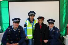 Constables Sean Burn and Alana McVicker with Aiden and Micah Ambion.