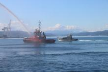 The Centre Port tug salutes as Lady Liz passes.