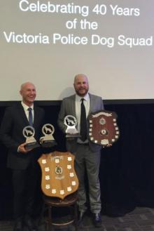 Senior Constables Owen Davies and Dave Robison with their trophies.
