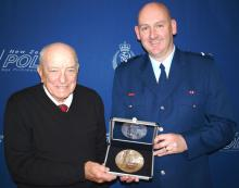 Graham McColl (Pvt McColl's nephew) and Senior Constable Karl Williams