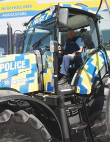 Rural beat: Cambridge Sergeant Gordon Grantham gets to grips with the new tractor