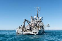 The Royal New Zealand Navy's diving support vessel HMNZS MANAWANUI at the site of the sunken FV Jubilee