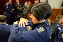 Two new constables embrace after taking their oath on Tuesday