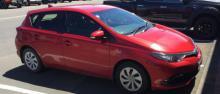 2016 red Toyota Corolla