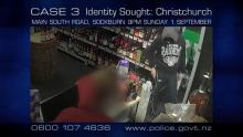 man wearing black pant and black hoodies, covered face holding knife in liquor shop