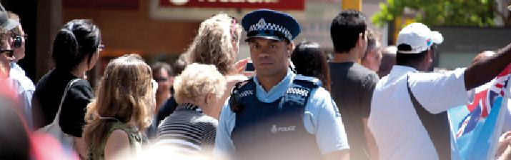 Police officer looking after crowed safety