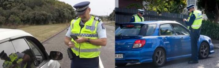 Police issuing ticket to offender