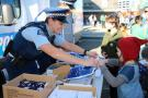 Constable Alana McVicker on giveaway duty.
