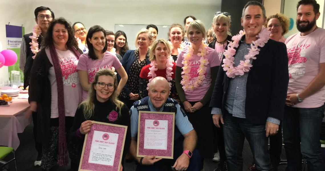 Senior Constable Bryan Ward, and entertainer Suzy Cato, receive their Pink Shirt awards.