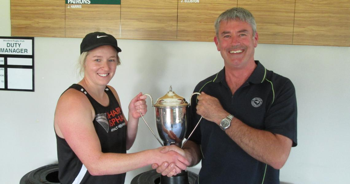 Organiser Tony Maw presents the Division 1 trophy to the PST captain Kat Hose. Photo: Bruce Cosgrove.