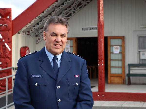 Inspector Rob Rutene standing in front of the marae.