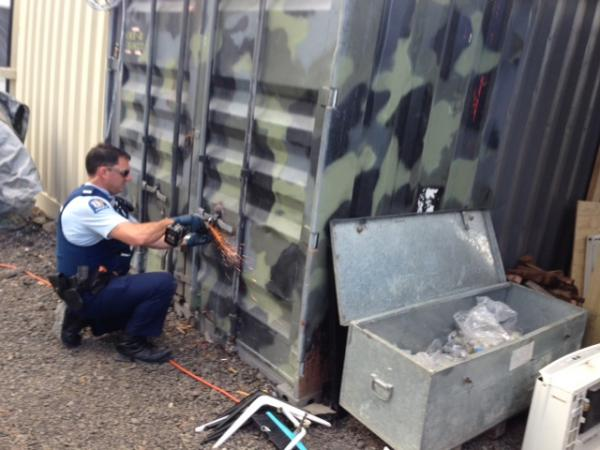 Constable Steven Stairmand grinds off a padlock