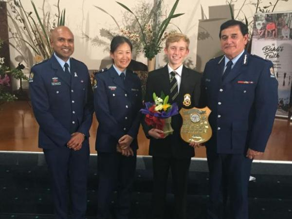 Inspector Rakesh Naidoo, Senior Constable Elizabeth Young and Deputy Commissioner Haumaha with the winner, Robbie White