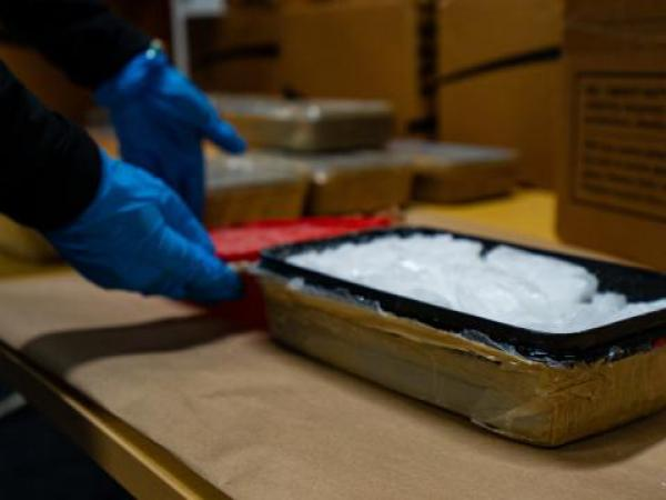 One of the plastic containers containing meth