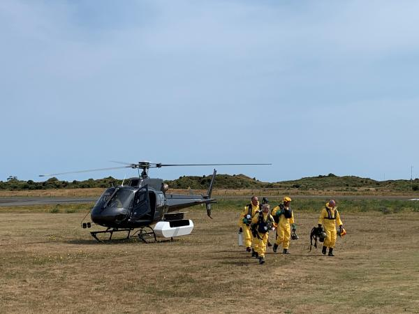 Police staff returning from Whakaari/White Island.