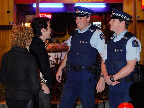 Young people chatting with police on a night out