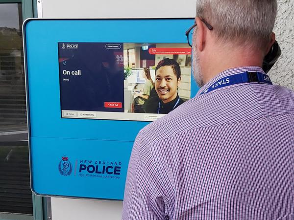 Photo of someone using Police Connect (outdoor)