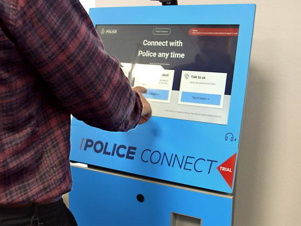 Photo of someone using Police Connect (indoor)