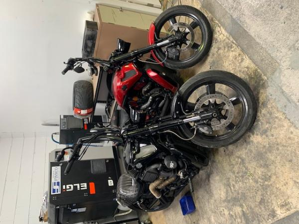 Two motorbikes in a garage