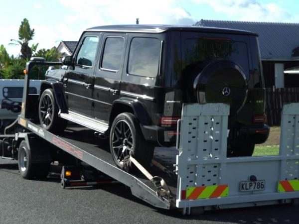 A Mercedez G-Wagon restrained during today's search warrants