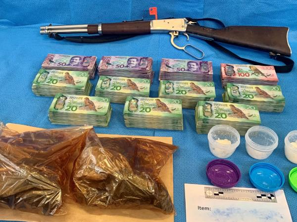 Meth, Iodine tablets, cash and a firearm were recovered from the address