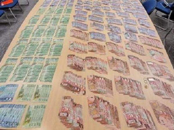 More than $100k in cash was located at the address