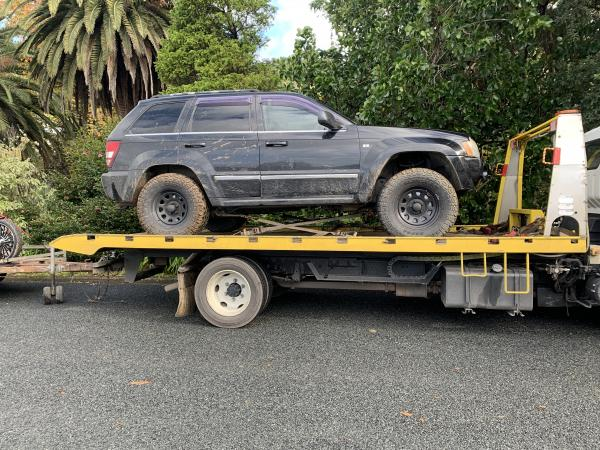 A Jeep Cherokee was restrained from the address