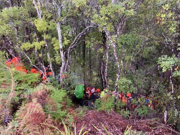 Police and volunteers on Parihaka in the search for mising man Brian Bench.