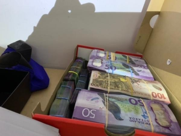 Some of the cash seized in search warrants yesterday