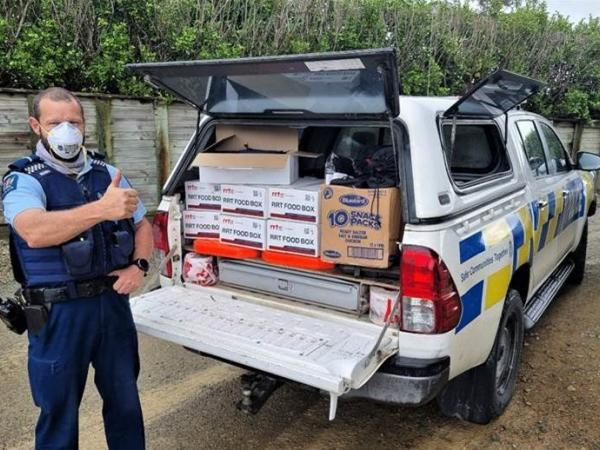 Police vehicle packed with food boxes in Maungaturoro