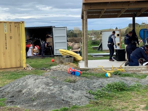 Police staff search a property in Wairoa today