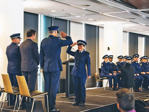A photo of a new constable from Wing 333 saluting