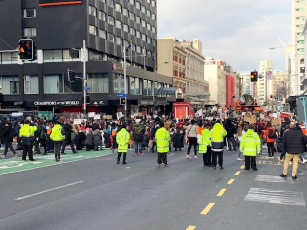 Māori and Pacific Wardens march with the protestors in Queen Street.